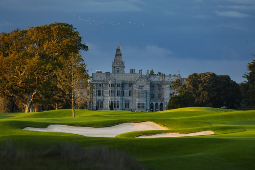 The 9th hole and clubhouse at Adare Manor.