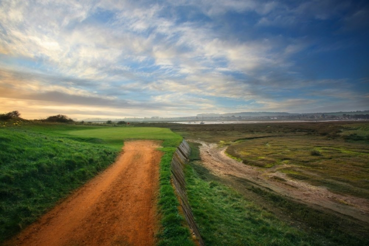 The famous 9th green access by path at Royal West Norfolk Golf Club.
