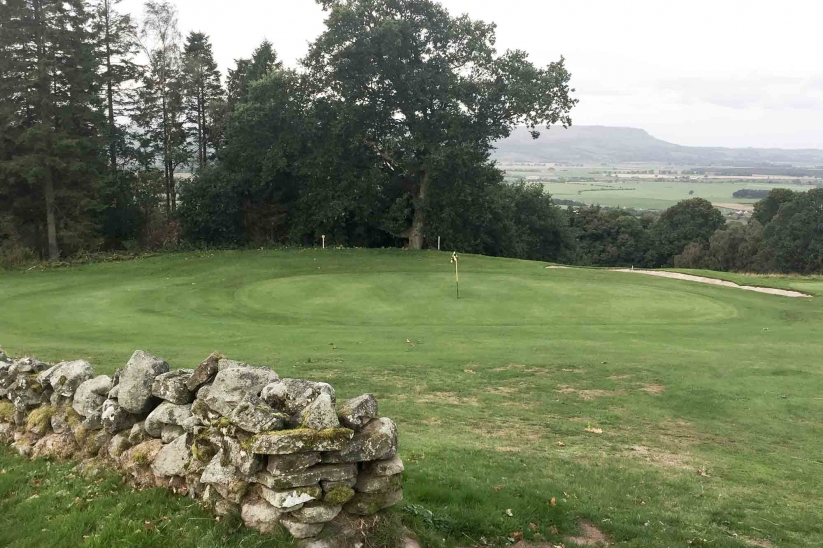 The stone walls on the 4th hole at The moody skies over Bridge of Allan Golf Course.