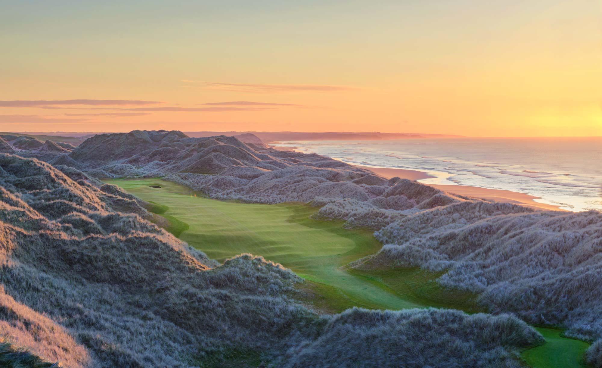 The 14th hole at sunrise at Trump International Scotland.