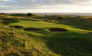 Pot bunkers surround the green at Silloth-on-Solway Golf Club which is part of the Alister MacKenzie Travel Guide.