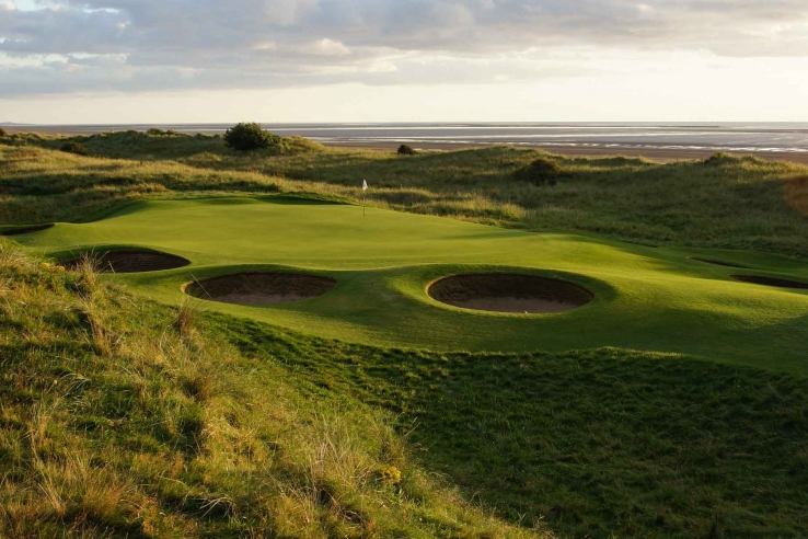 Pot bunkers surround the green at Silloth-on-Solway Golf Club.
