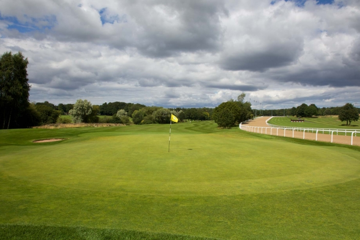 A green with the racecourse behind at Northumberland Golf Club.