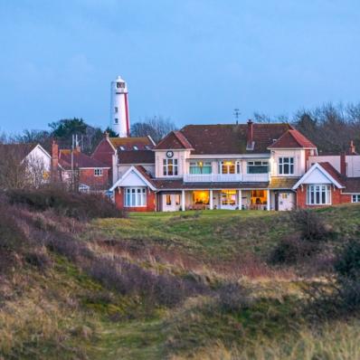 The Burnham & Berrow Golf Club clubhouse at dusk.