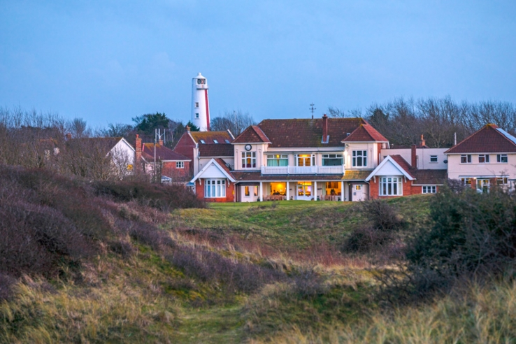 The Burnham & Berrow Golf Club clubhouse at dusk.
