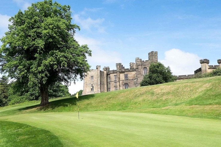 A photo of Brancepeth Castle Golf Club with Brancepeth Castle in the background.