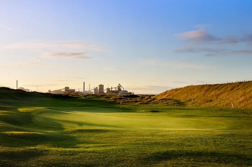 Cleveland Golf Club with the steel plant in the background.