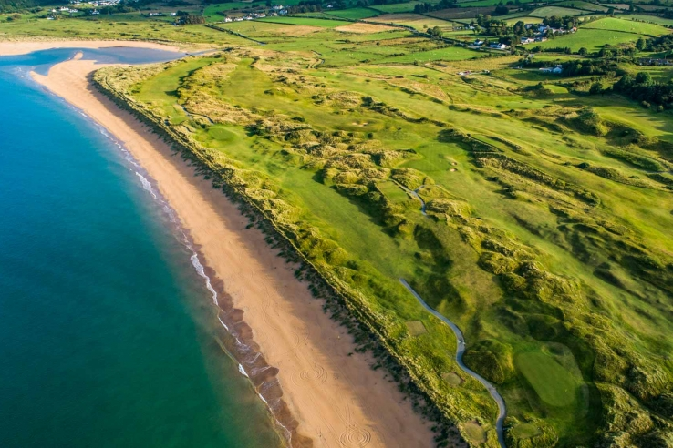 A drone photo of the beach adjacent to the links at Portsalon Golf Club in Ireland.