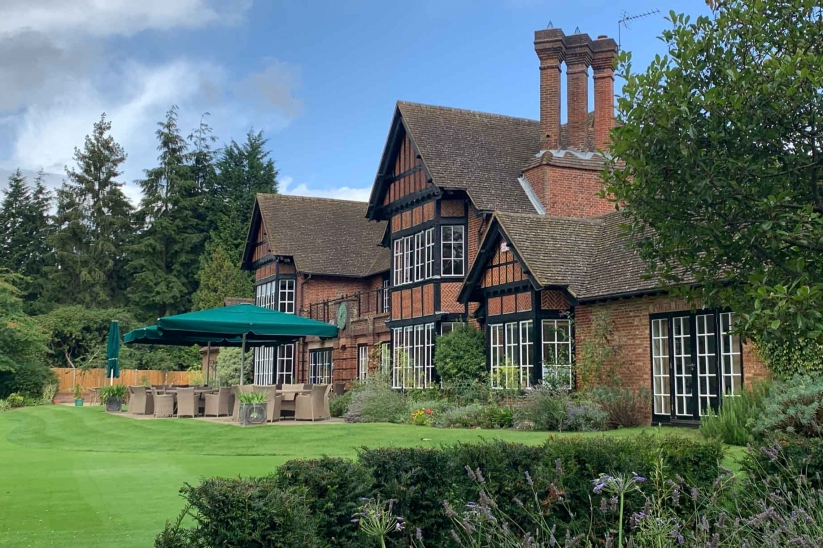 The red brick clubhouse at Swinley Forest Golf Club.