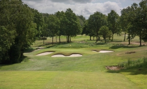 A green complex surrounded by bunkers at Sand Moor Golf Club which is featured in the Alister MacKenzie Travel Guide.