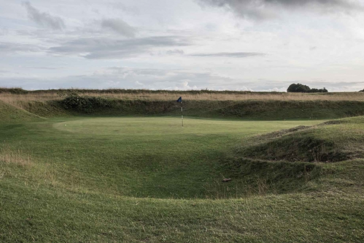 The iconic punchbowl green at Minchinhampton Golf Course.