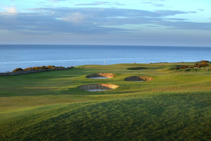 Revetted pot bunkers and the North Sea behind.