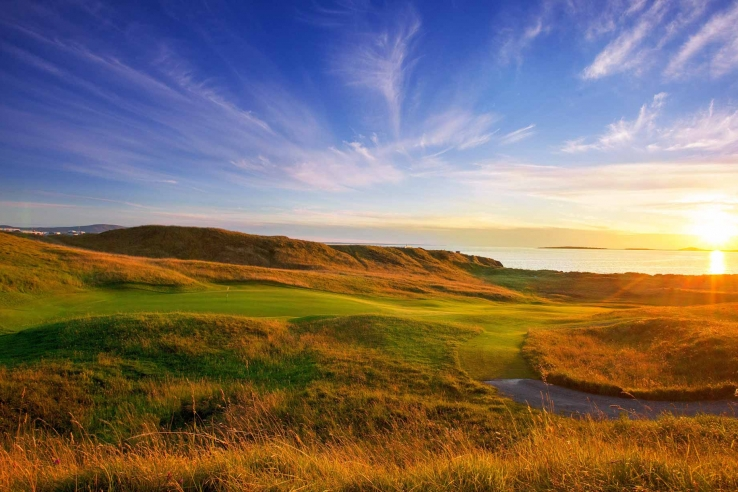 A photo of sunset over the pure links of County Sligo Golf Club.
