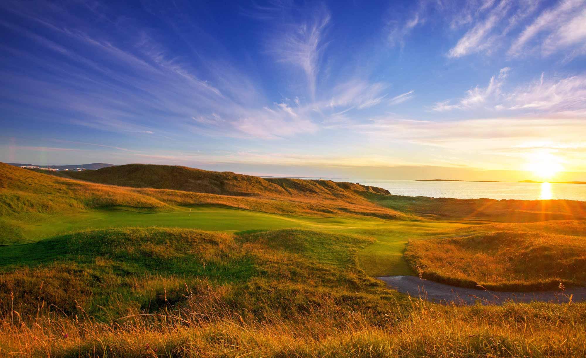 A photo of sunset over the pure links of County Sligo Golf Club.