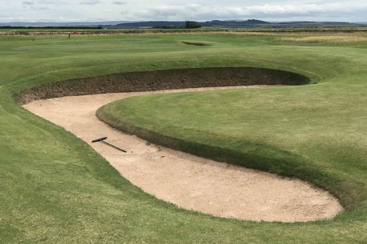 A photo of the unique shapes of the revetted bunkers at Muirfield.