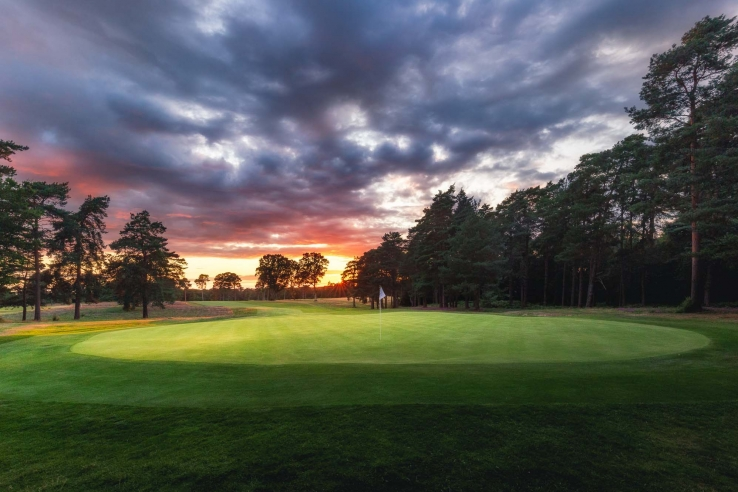 A photo at sunrise of the 11th hole at Woking Golf Club.