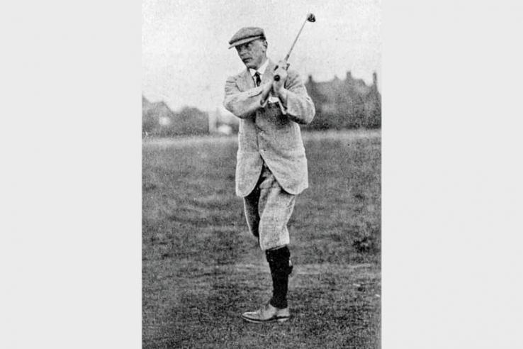 A photo of Harry Colt swinging a golf club.