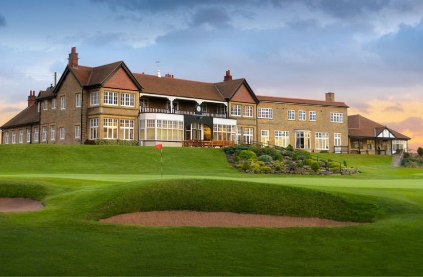 The clubhouse and 18th green at Lindrick Golf Club.