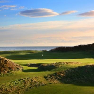 The 9th green with Irish Sea behind Royal County Down Golf Club.
