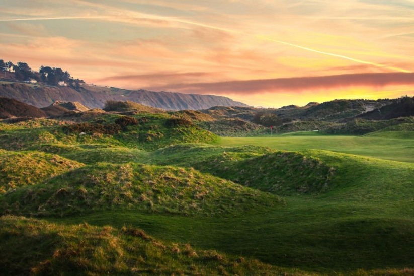 A photo at sunrise of Royal St David's Golf Club, or Harlech, in Wales.