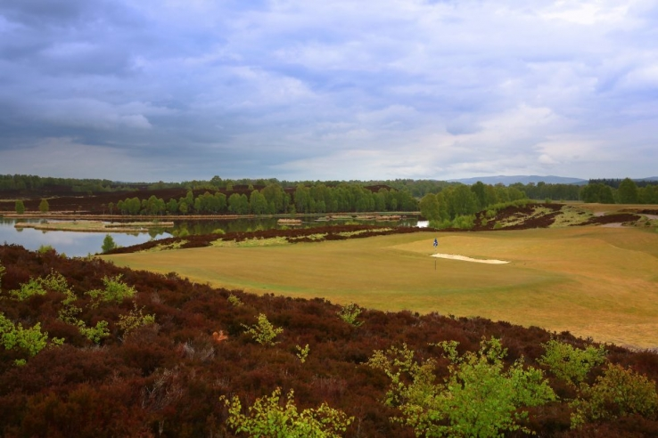 The moorland Spey Valley Golf Course in Scotland with heather in bloom.
