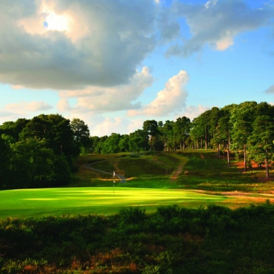 The famous 8th hole from behind at St Georges Hill Golf Club.