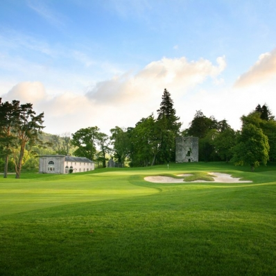 The 18th green with ruins behind at Loch Lomond Golf Club.