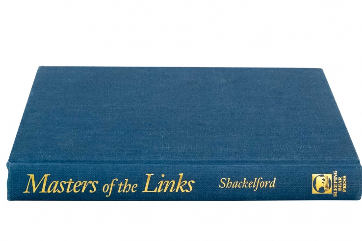 A photo of the book Masters Of The Links by Geoff Shackelford.