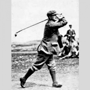 Golf Course Architect Sir Guy Campbell holding his pose after a swing.