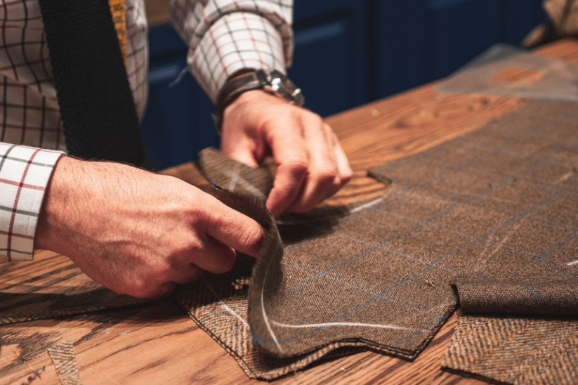 Edel custom fit putters mirror the craft of a Saville Row Tailor shown here.